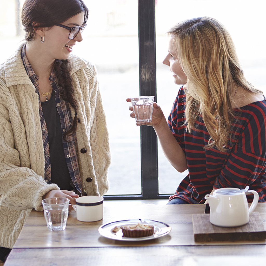 Women talking and a cup of joe